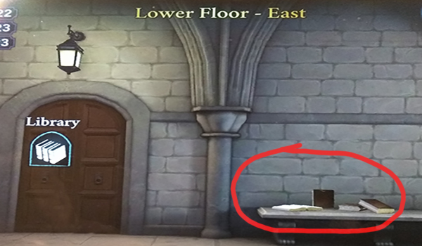 Lower Floor - East free energy location is a pile of books in Hogwarts Mystery